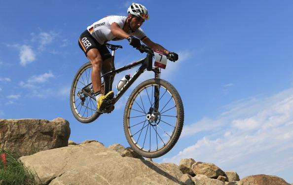 HADLEIGH, ESSEX - AUGUST 12: Manuel Fumic of Germany competes in the Men's Cross-country Mountain Bike race on Day 16 of the London 2012 Olympic Games at Hadleigh Farm on August 12, 2012 in Hadleigh, England.  (Photo by Phil Walter/Getty Images)