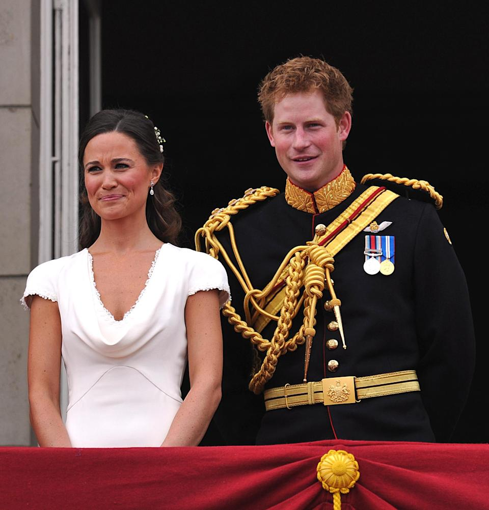 Pippa Middleton and Prince Harry appear on the balcony of Buckingham Palace, London, following the wedding of Prince William and Kate Middleton at Westminster Abbey, Friday April 29, 2011. (AP Photo/John Stillwell, Pool)