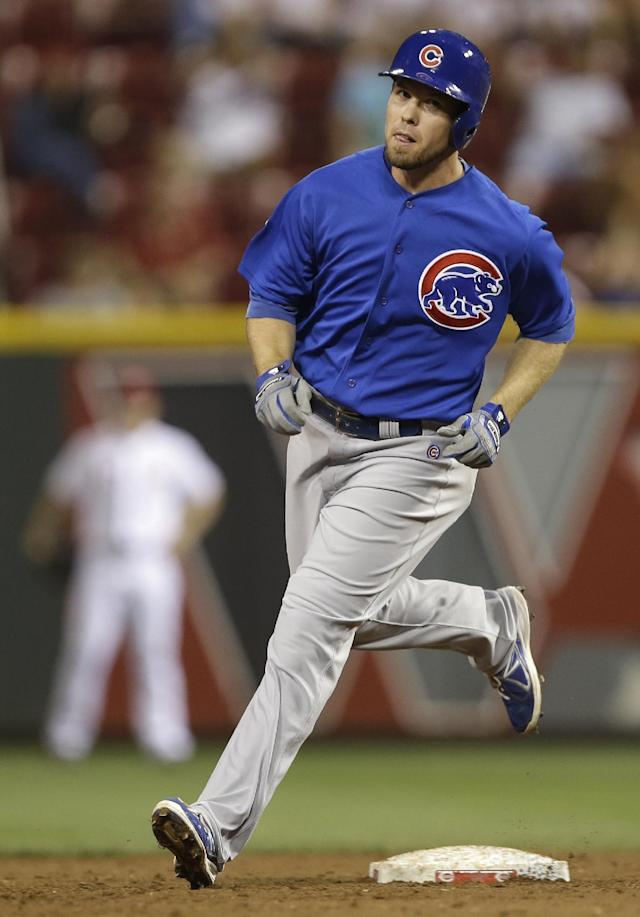 Chicago Cubs' Donnie Murphy rounds the bases after hitting a two-run home run off Cincinnati Reds relief pitcher Greg Reynolds in the third inning of a baseball game, Tuesday, Sept. 10, 2013, in Cincinnati. (AP Photo/Al Behrman)