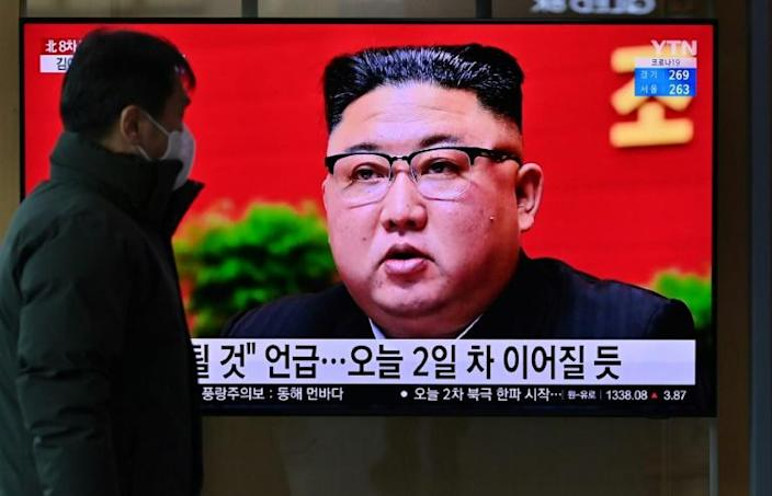 A man watches a television screen showing news footage of North Korean leader Kim Jong Un attending the 8th congress of the ruling Workers' Party held in Pyongyang, at a railway station in Seoul on January 6, 2021