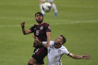 Mexico's Jose Esquivel, left, heads the ball challenged by United States' Djordje Mihailovic during a Concacaf Men's Olympic Qualifying championship soccer match in Guadalajara, Mexico, Wednesday, March 24, 2021. (AP Photo/Fernando Llano)
