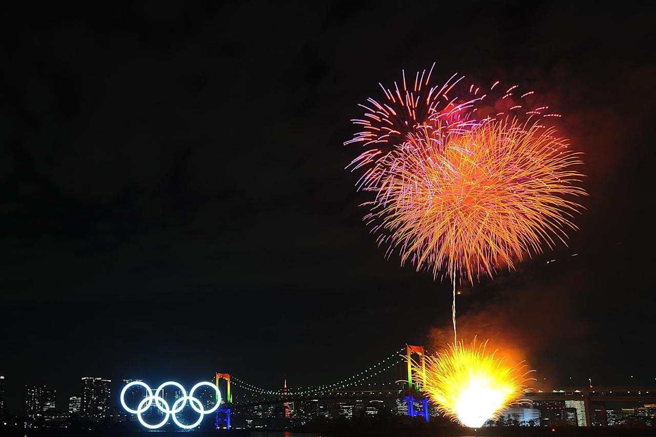 TOKYO, JAPAN - JANUARY 24: Fireworks explode as Olympic rings are illuminated for the first time to mark 6 months to go to the Olympic games at Odaiba Marine Park on January 24, 2020 in Tokyo, Japan. (Photo by David Mareuil/Anadolu Agency via Getty Images)