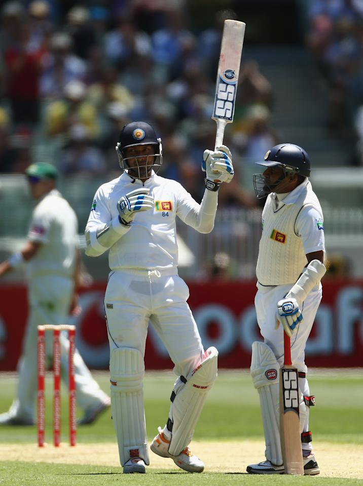 MELBOURNE, AUSTRALIA - DECEMBER 26: Kumar Sangakkara of Sri Lanka raises his bat after reaching tenthousand career runs during day one of the Second Test match between Australia and Sri Lanka at Melbourne Cricket Ground on December 26, 2012 in Melbourne, Australia.  (Photo by Robert Cianflone/Getty Images)