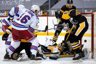 New York Rangers' Ryan Strome (16) lifts a rebound over Pittsburgh Penguins goaltender Tristan Jarry (35) for a goal during the second period of an NHL hockey game in Pittsburgh, Sunday, Jan. 24, 2021. (AP Photo/Gene J. Puskar)
