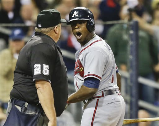 Atlanta Braves' Justin Upton rants against home plate umpire Fieldin Culbreth after being called out on strikes to end the eighth inning against the San Diego Padres in a baseball game in San Diego, Tuesday, June 11, 2013. (AP Photo/Lenny Ignelzi)