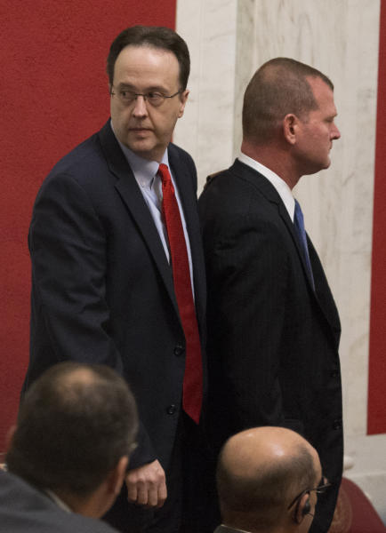 West Virginia Supreme Court justice, Allen Loughry, left, arrives in the Senate chambers with his attorney John Carr, right, during a pre-trial impeachment conference in the West Virginia State Senate chambers at the Capitol in Charleston, W,Va., Tuesday, Sept. 11, 2018. (AP Photo/Steve Helber)