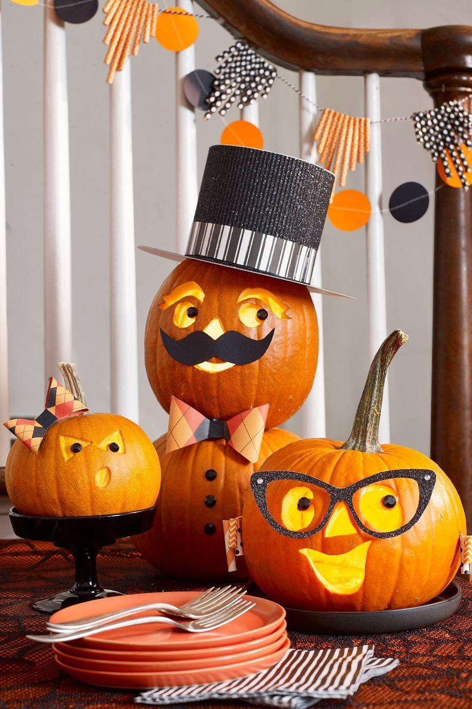 "<p>Statement accessories like cat-eye glasses, a top hat, and earrings give this family of pumpkins some serious style.</p><p><em><strong><a href=""https://www.womansday.com/home/crafts-projects/g22840971/halloween-2018-templates/"" rel=""nofollow noopener"" target=""_blank"" data-ylk=""slk:Get the Family Pumpkins tutorial."" class=""link rapid-noclick-resp"">Get the Family Pumpkins tutorial.</a></strong></em></p>"