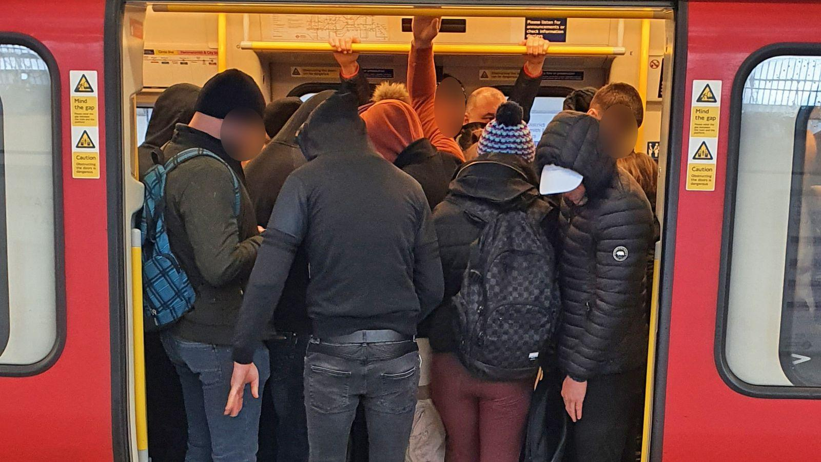 A packed train in London on Monday, when an Italian expert says the UK should have been locked down