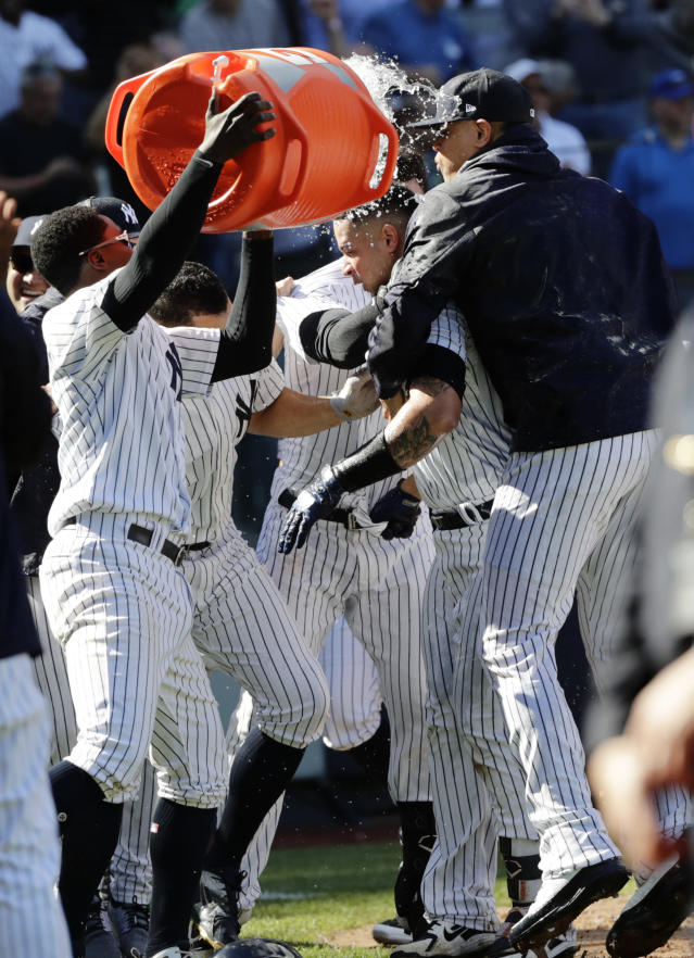 New York Yankees' Gary Sanchez, center, celebrates with teammates after hitting a three-run home run during the ninth inning of a baseball game against the Minnesota Twins Thursday, April 26, 2018, in New York. The Yankees won 4-3. (AP Photo/Frank Franklin II)