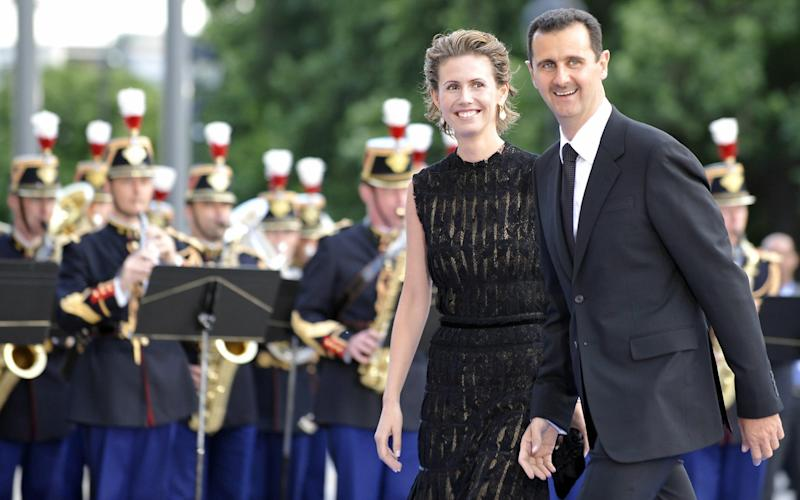 Syrian President Bashar al-Assad and his wife Asma al-Assad arrive at the Petit Palais, Paris, after attending the Union for the Mediterranean founding summit in July 2008 - Credit: GERARD CERLES/AFP