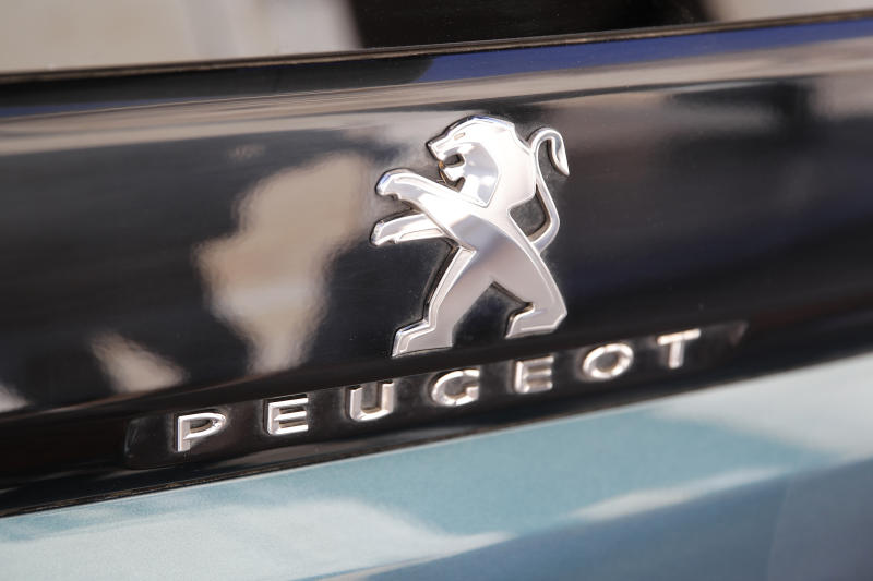 The logo of the French car maker Peugeot is pictured Wednesday, Dec.18, 2019 in Paris. The boards of Fiat Chrysler Automobiles and PSA Peugeot on Wednesday signed a binding merger deal creating the world's fourth-largest automaker with the scale to confront the challenges of stricter emissions regulations and the transition to new driving technologies. (AP Photo/Francois Mori)