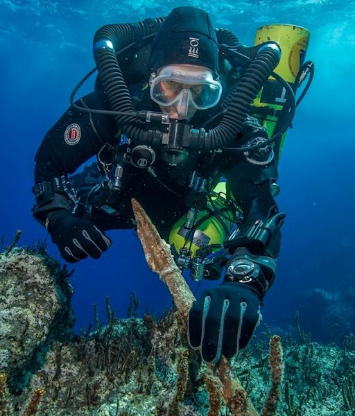 "Project chief diver of the ""Return to Antikythera"" mission, Philip Short examines a bronze spear removed from the ancient Greek shipwreck."