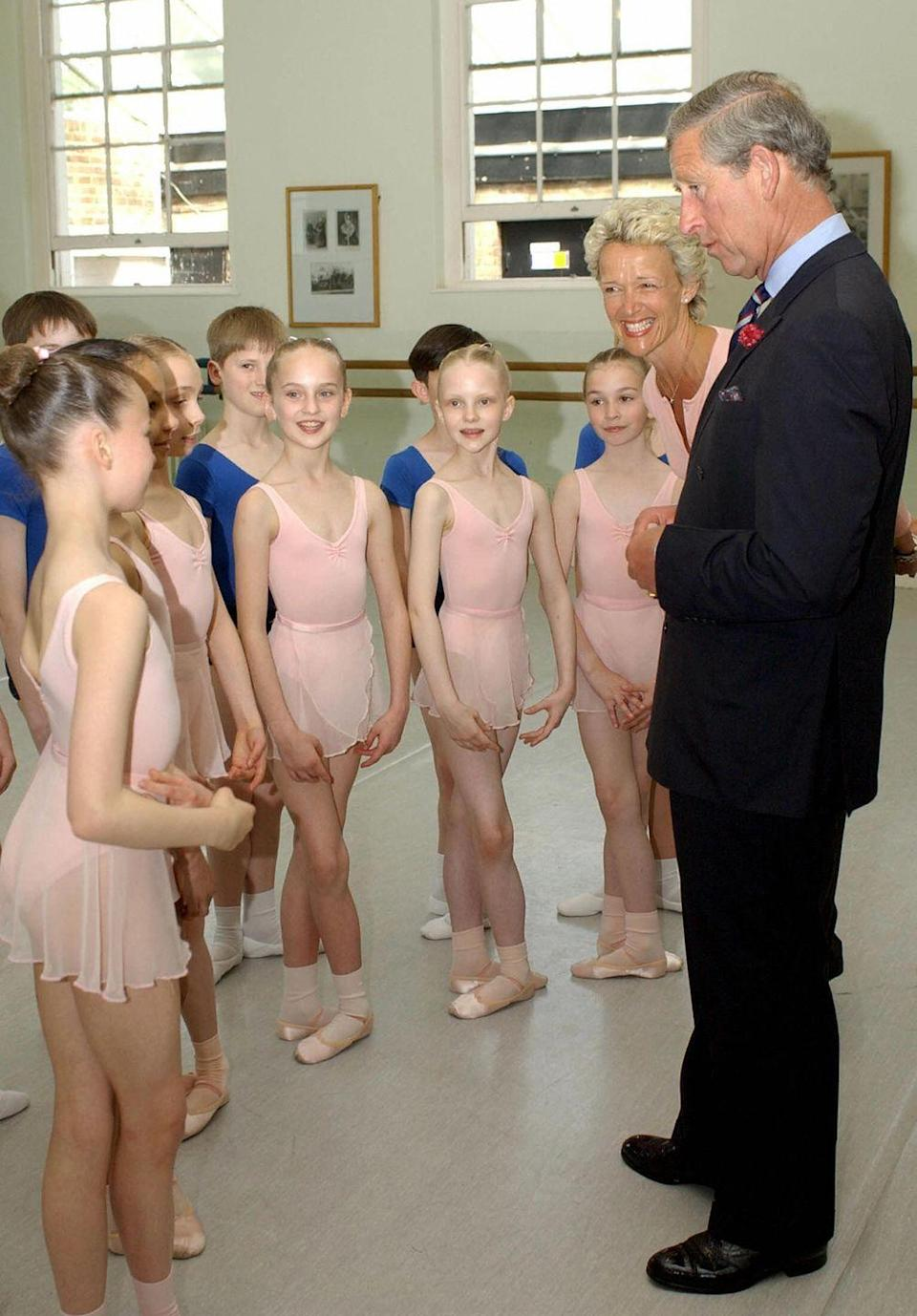 <p>Prince Charles talks to pupils at the White Lodge School after observing their lesson.</p>