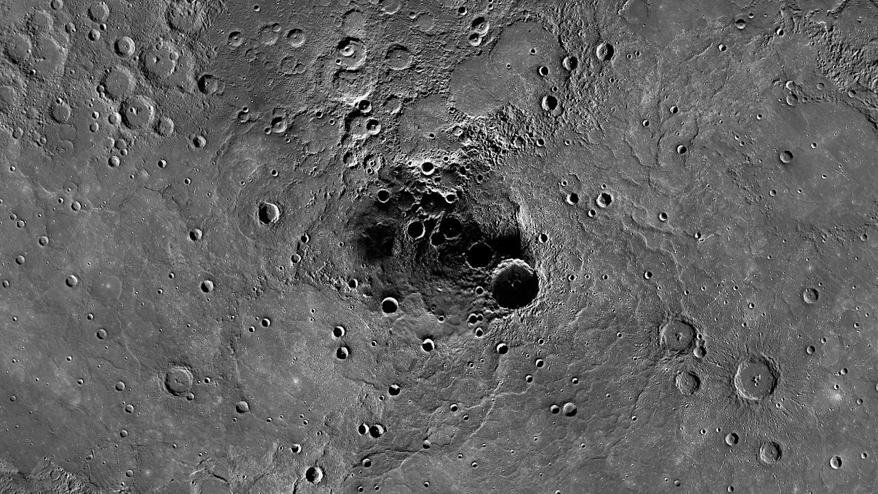 This photo made available by NASA/Johns Hopkins University Applied Physics Laboratory/Carnegie Institution of Washington on Tuesday, Nov. 27, 2012 shows a 68-mile-diameter crater, large indentation at center, in the north polar region of Mercury which has been shown to harbor water ice, thanks to measurements by the Messenger spacecraft. Scientists made the announcement Thursday, Nov. 29, 2012. (AP Photo/NASA/Johns Hopkins University Applied Physics Laboratory/Carnegie Institution of Washington)