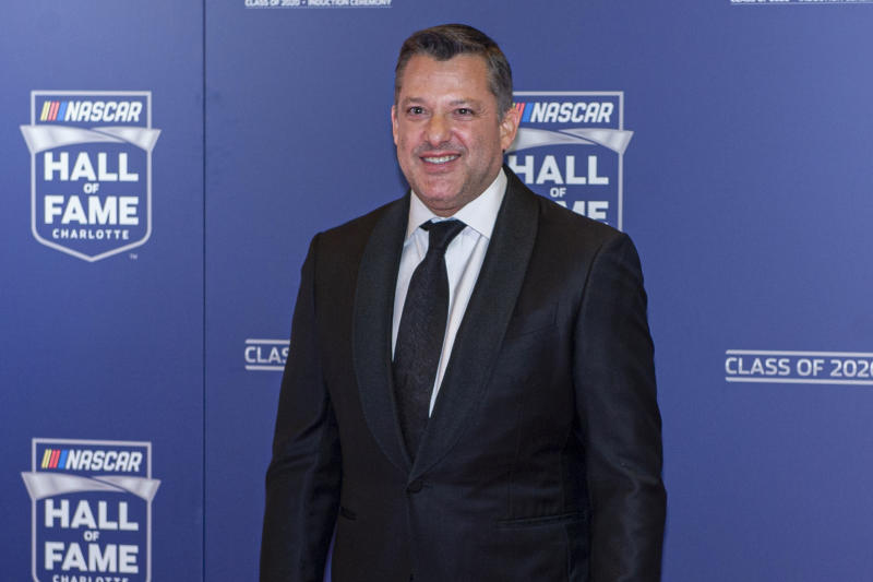 NASCAR Hall of Fame inductee Tony Stewart poses for pictures prior to the induction ceremony in Charlotte, N.C., Friday, Jan. 31, 2020. (AP Photo/Mike McCarn)