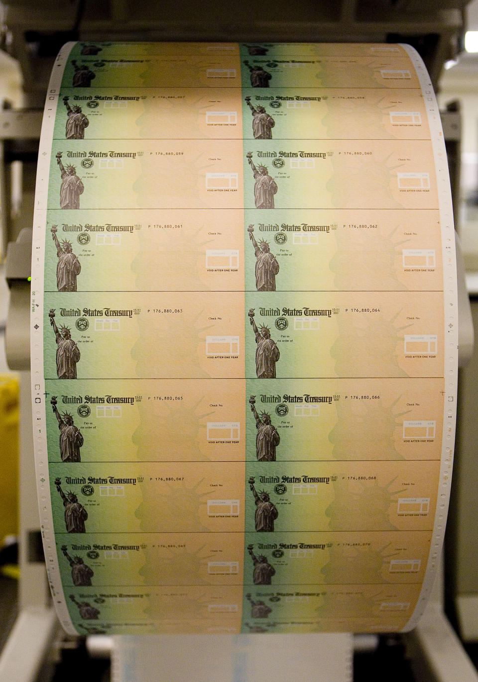 PHILADELPHIA - MAY 8:  Economic stimulus checks are prepared for printing at the Philadelphia Financial Center May 8, 2008 in Philadelphia, Pennsylvania. One hundred and thirty million households are eligible to receive a tax rebate check under the $168 billion economic stimulus plan.  (Photo by Jeff Fusco/Getty Images)