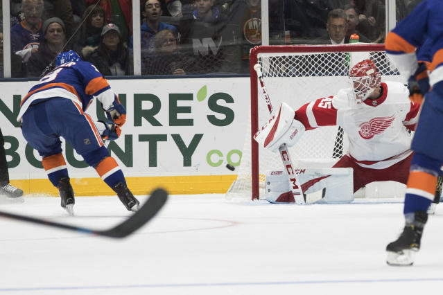 New York Islanders left wing Anthony Beauvillier, left, shoots to score against Detroit Red Wings goaltender Jonathan Bernier (45) during the first period of an NHL hockey game, Saturday, Dec. 15, 2018, in Uniondale, N.Y. (AP Photo/Mary Altaffer)