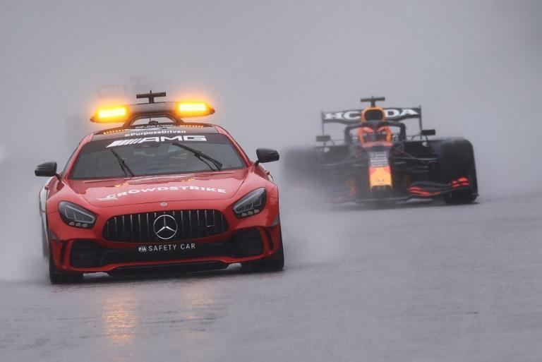 Damp squib: Max Verstappen followed the safety car for two laps at Spa-Francorchamps to claim a hollow victory and half points (AFP/KENZO TRIBOUILLARD)