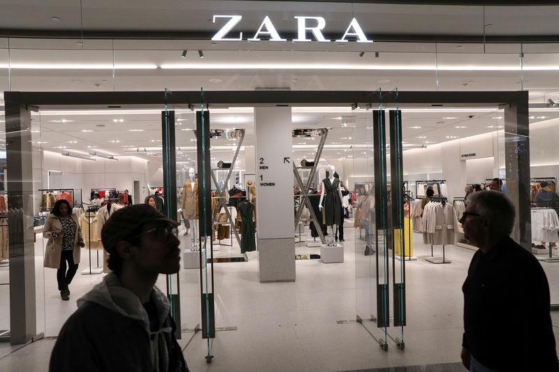 People shop at a Zara store during the grand opening of The Hudson Yards development in New York