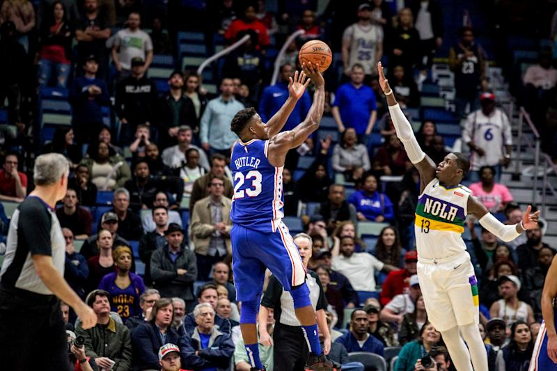 Philadelphia 76ers guard Jimmy Butler (23) shoots over New Orleans Pelicans forward Cheick Diallo (13) in the second half of an NBA basketball game in New Orleans, Monday, Feb. 25, 2019. The 76ers won 111-110. (AP Photo/Scott Threlkeld)