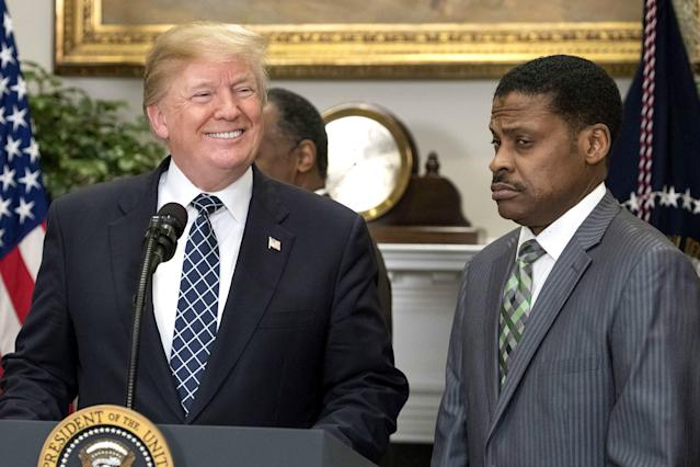 President Trump prior to signing a proclamation in honor of Martin Luther King Jr. Day, as Isaac Newton Farris Jr., King's nephew, looks on. (Photo: Rex/Shutterstock)