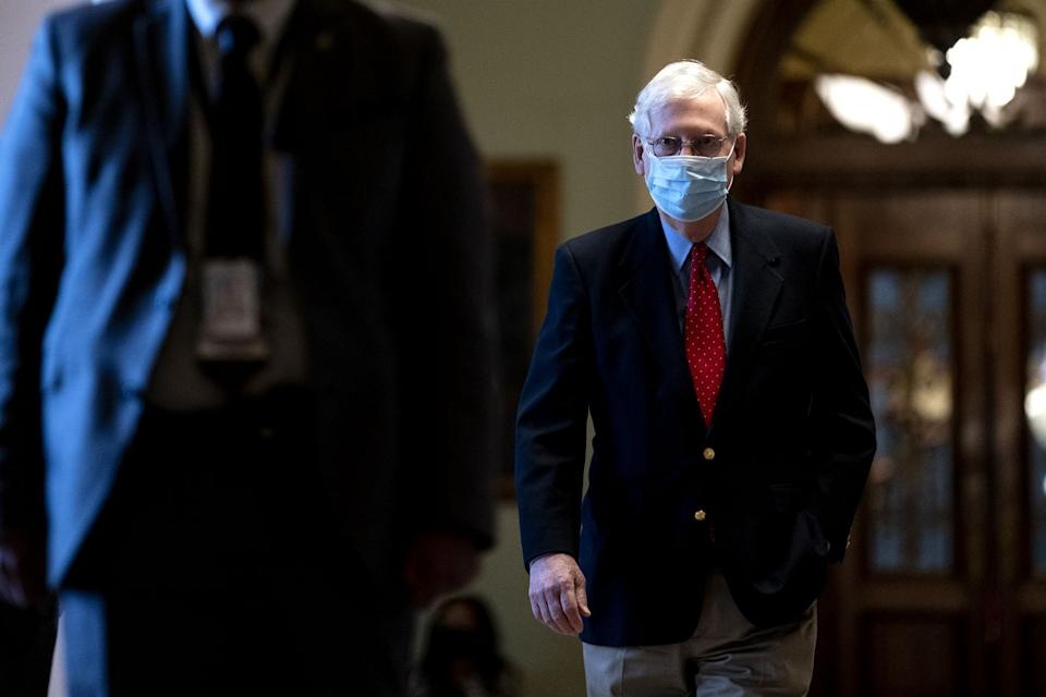 Mitch McConnell is seen wearing a mask.