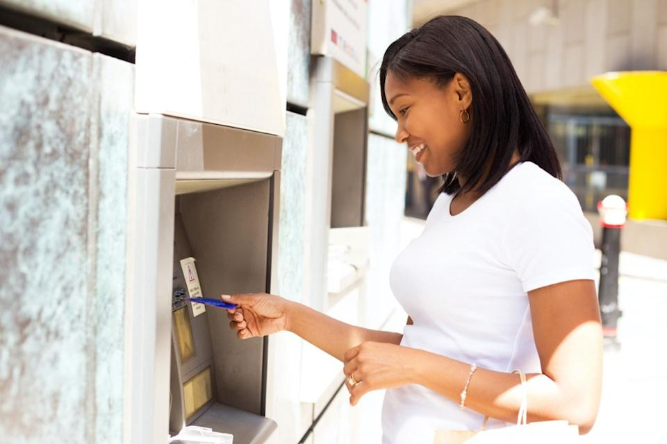 woman at the cash machine