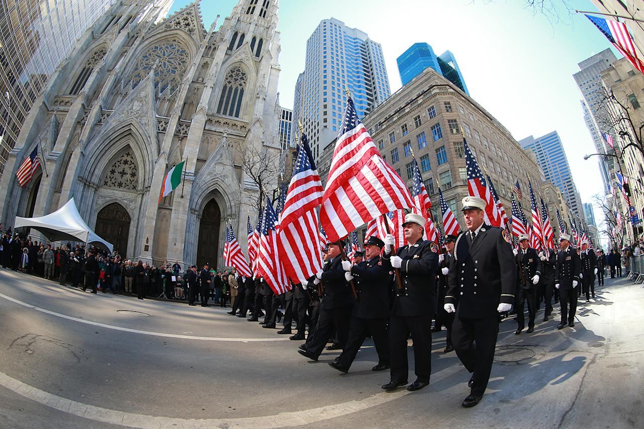 <p>Members of the Fire Department of New York <span>Color Guard </span>carry flags make their way onto Fifth Avenue during the St. Patrick's Day Parade on March 17, 2017, in New York. (Gordon Donovan/Yahoo News) </p>