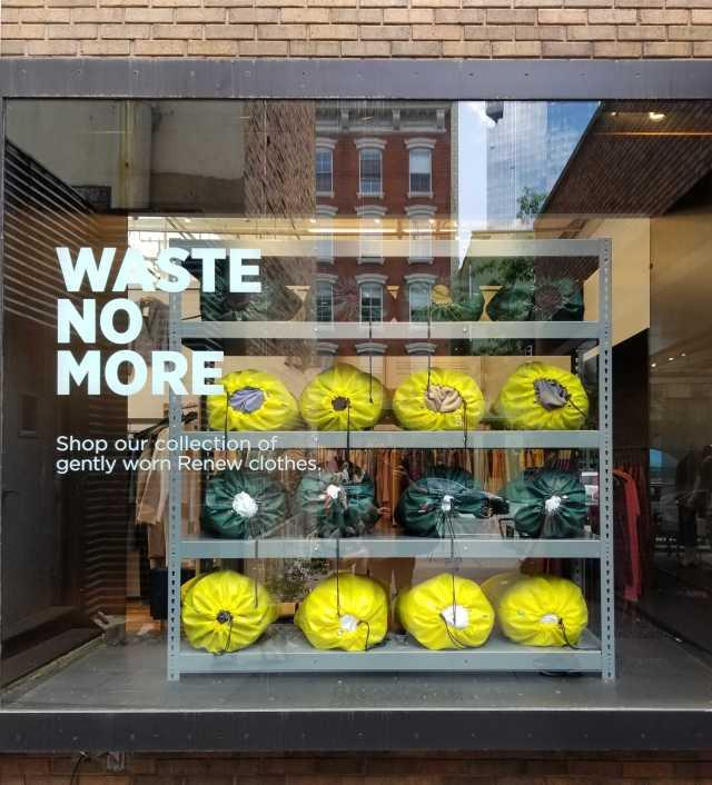 """A store window with the text """"Waste No More"""""""