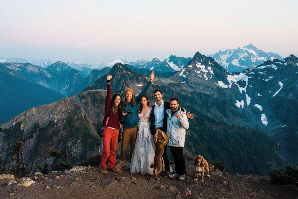 PHOTO: Brandon and Gabi Fox, far left, celebrate a successful adventure elopement. (Thefoxesphotography.com)