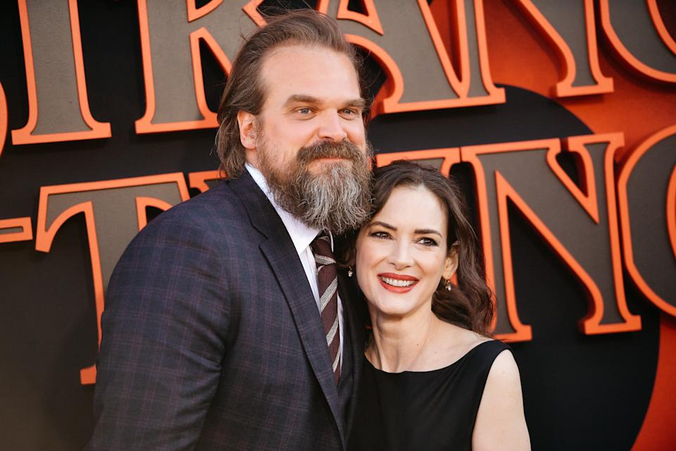 SANTA MONICA, CALIFORNIA - JUNE 28: (EDITORS NOTE: Image has been processed using digital filters) David Harbour and Winona Ryder attend the premiere of Netflix's