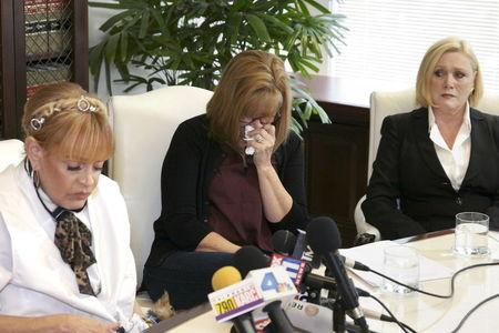 Burns, Kinney, and Tate attend a news conference announcing more allegations against comedian Bill Cosby in Los Angeles