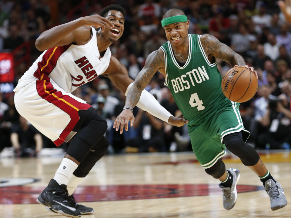 FILE - Boston Celtics guard Isaiah Thomas (4) drives to the basket past Miami Heat center Hassan Whiteside (21) during the second half of an NBA basketball game in Miami, in this Nov. 28, 2016, file photo. Two-time NBA All-Star Isaiah Thomas hopes playing this weekend with USA Basketball in FIBA AmeriCup qualifying in Puerto Rico gives an NBA club reason to sign him.. (AP Photo/Wilfredo Lee)