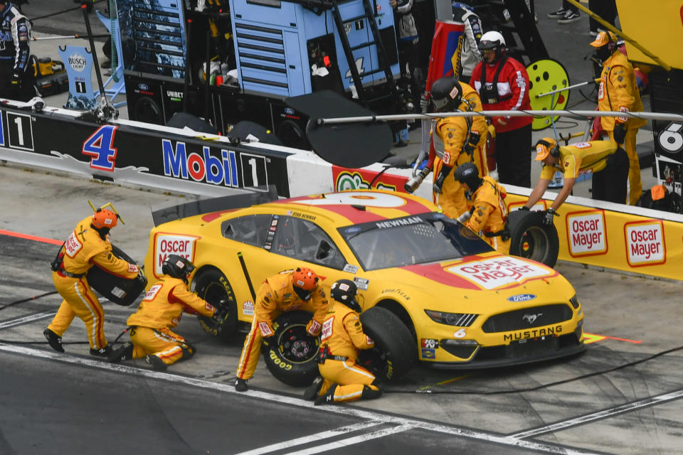 Ryan Newman makes a pit stop during a NASCAR Cup Series auto race, Sunday, July, 11, 2021, in Hampton, Ga. (AP Photo/John Amis)