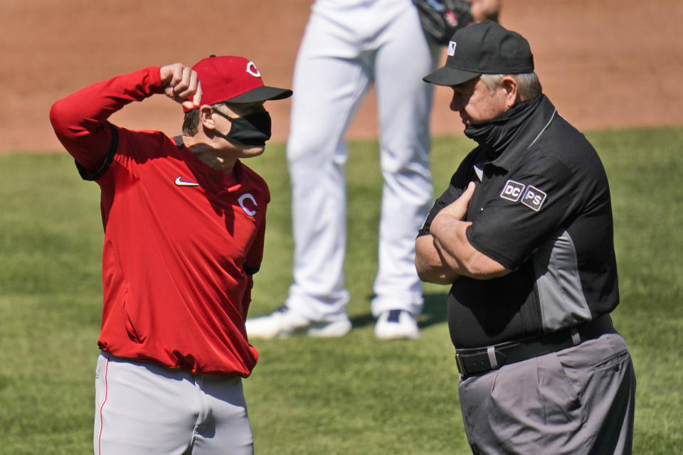 Cincinnati Reds manager David Bell, left, argues after being ejected by umpire Joe West, right, during the sixth inning of a baseball game Sunday, April 25, 2021, in St. Louis. (AP Photo/Jeff Roberson)