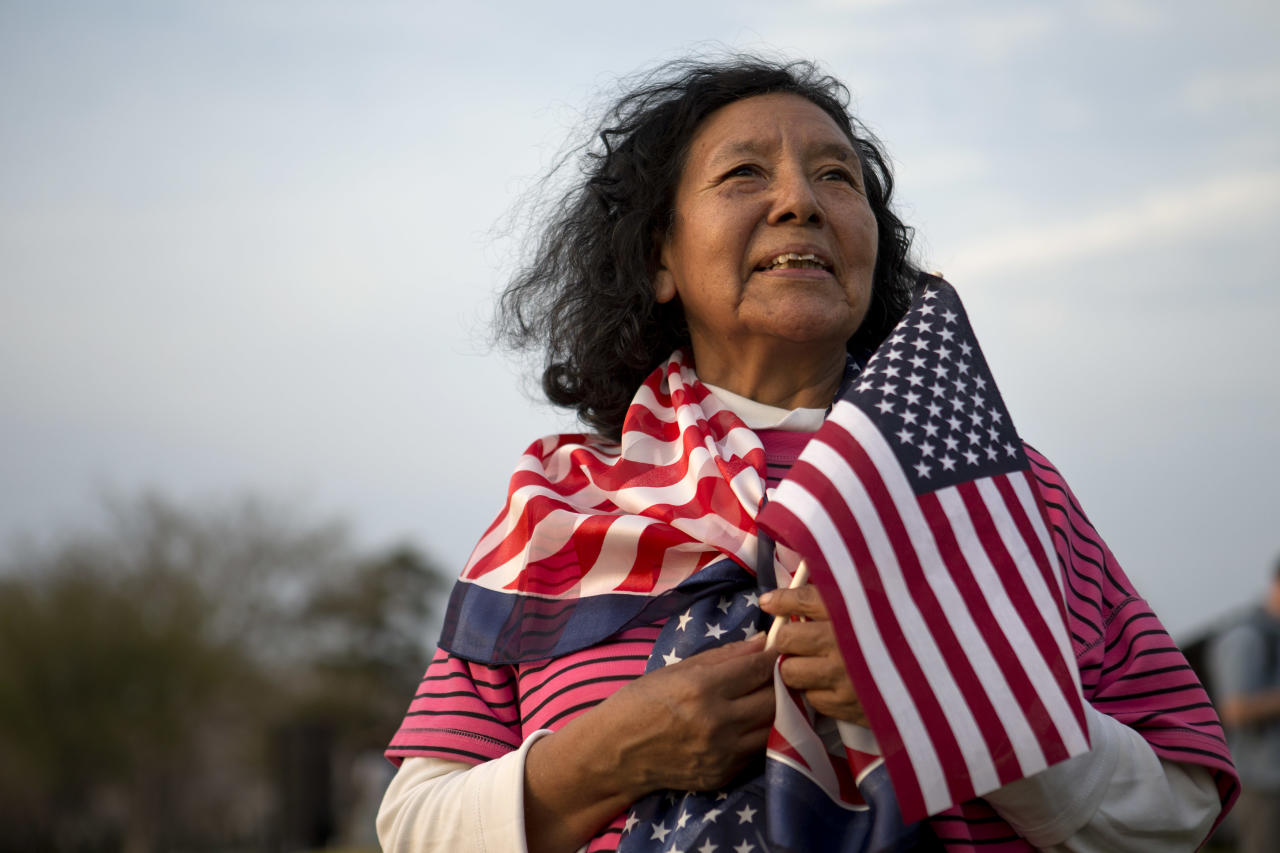 "Alejandra Tejada, 55, an American citizen living in Arlington, Va. who is originally from Bolivia, poses for a portrait at the end of the ""Rally for Citizenship,"" a rally in support of immigration reform, on Capitol Hill in Washington, on Wednesday, April 10, 2013. Bipartisan groups in the House and Senate are said to be completing immigration bills that include a pathway to citizenship for the nation's 11 million immigrants with illegal status. ""As an immigrant myself I support immigration reform,"" says Tejada. (AP Photo/Jacquelyn Martin)"
