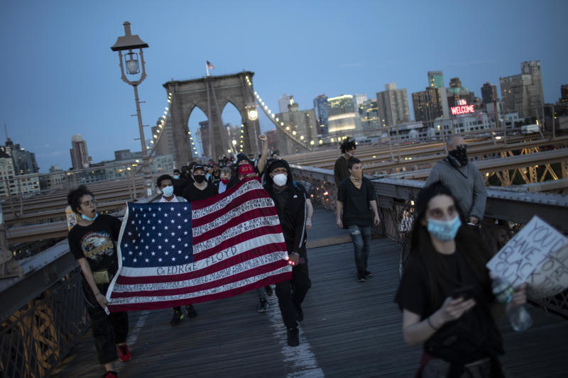 Protesters march across the Brooklyn Bridge as part of a solidarity rally calling for justice over the death of George Floyd Monday, June 1, 2020, in the Brooklyn borough of New York. Floyd died after being restrained by Minneapolis police officers on May 25. (AP Photo/Wong Maye-E)