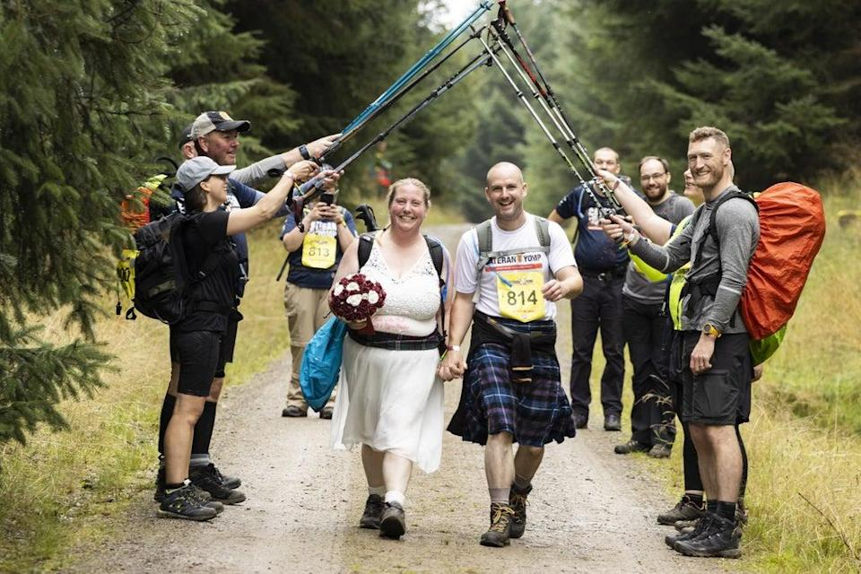 Emma Adams took part in her wedding dress, with husband Andy in his kilt (Chris Walker/ABF) (PA Media)