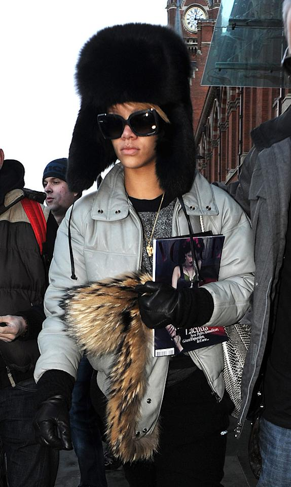 """She may have taken it all off in this month's <i>GQ</i>, but Rihanna certainly kept everything under cover this week while braving London's lousy weather in a monstrous fur chapeau. What do you think of her hat? Hot or not? Gotcha Images/<a href=""""http://www.splashnewsonline.com"""" target=""""new"""">Splash News</a> - December 17, 2009"""
