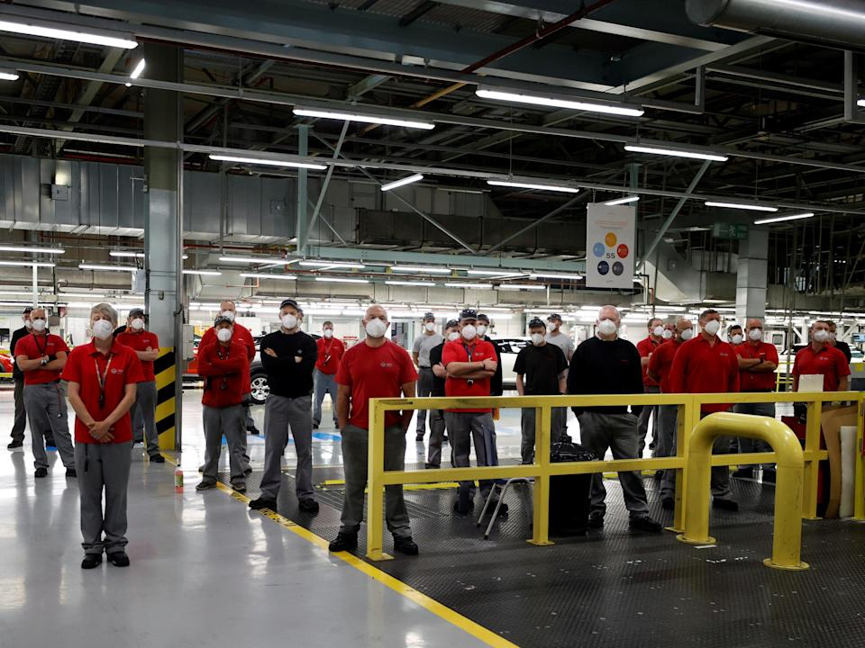 Nissan factory workers listen to the company's announcement during a news conference at the Sunderland plant (Phil Noble/Reuters)