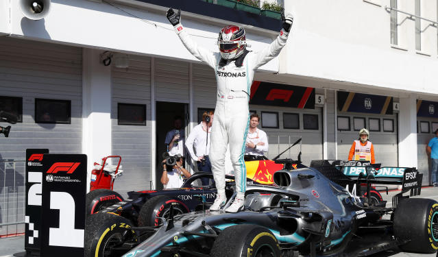 Mercedes driver Lewis Hamilton of Britain celebrates after winning the Hungarian Formula One Grand Prix at the Hungaroring racetrack in Mogyorod, northeast of Budapest, Hungary, Sunday, Aug. 4, 2019. (AP Photo/Laszlo Balogh)
