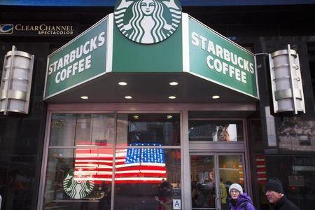 Starbucks to boost pay, benefits after U S  lowers corporate