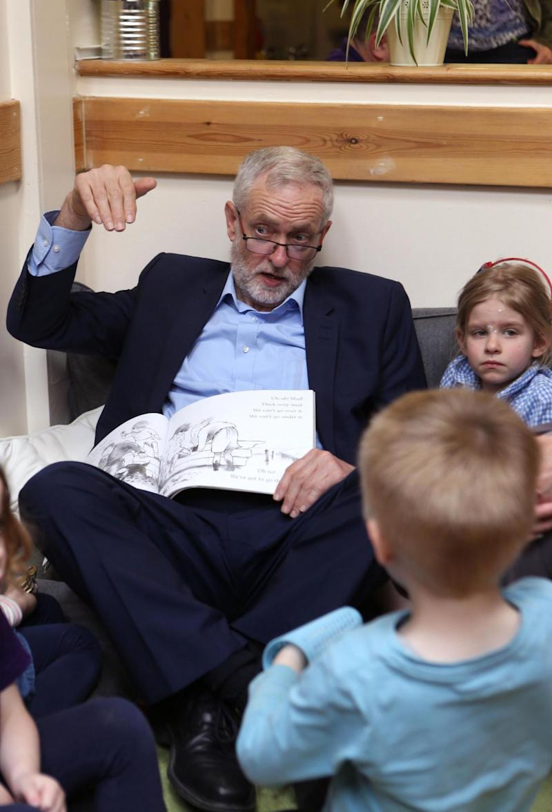 Labour leader Jeremy Corbyn talks to children as he visits Brentry Children Centre in Bristol (PA)