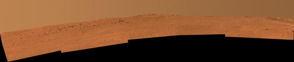 """The boulder-studded ridge in this scene recorded by NASA's Mars Exploration Rover Opportunity is """"McClure-Beverlin Escarpment."""" This view toward the south is a mosaic of images taken by Opportunity's panoramic camera (Pancam) on Dec. 25, 2013."""