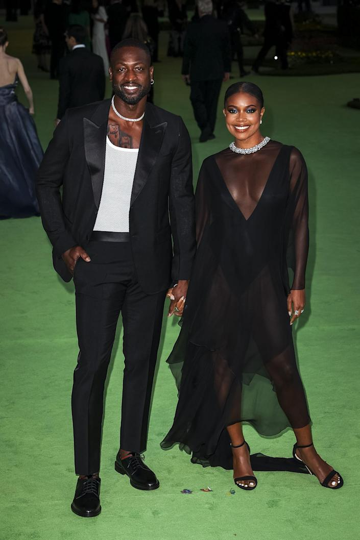 <p>The couple stunned in coordinating looks - right down to the jeweled necklines - at the opening gala for the Academy Museum of Motion Pictures. </p>