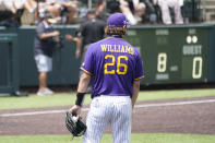 East Carolina pitcher Gavin Williams (26) waits as umpires, background, review a play at the plate during the eighth inning of an NCAA college baseball super regional game against Vanderbilt, Friday, June 11, 2021, in Nashville, Tenn. The call was reversed and Vanderbilt's run counted. Vanderbilt won 2-0. (AP Photo/Mark Humphrey)