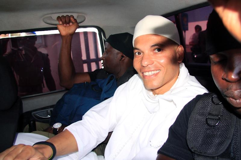 File photo shows Karim Wade, son of Senegal's former President Abdoulaye Wade, arriving at a court in Dakar on July 31, 2014 for the start of his trial for charges of illicit enrichment (AFP Photo/)
