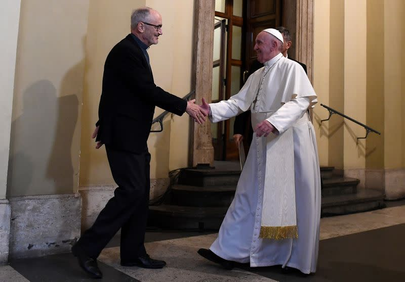 FILE PHOTO: Pope Francis shakes hands with Under-Secretary of the Migrants and Refugees Section of the Dicastery for Promoting Integral Human Development, Michael Czerny, during an audience with refugees arriving from Lesbos at the Vatican