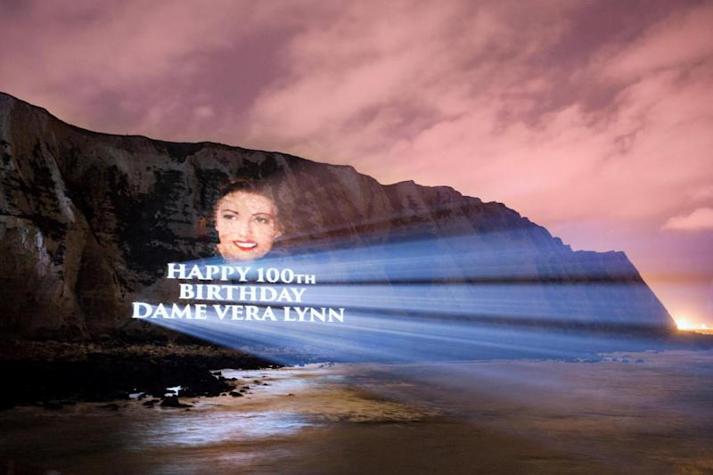 Celebration: a practice run shows Dame Vera Lynn's face projected onto cliffs of Dover as star turns 100 (PA)