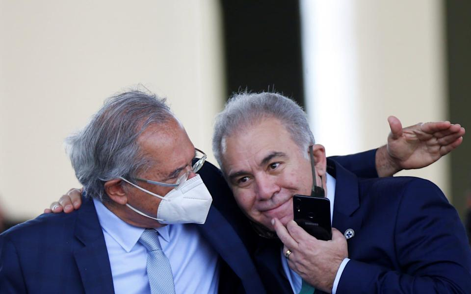 Brazil's Health Minister Marcelo Queiroga (R) tested positive while at UNGA - Reuters
